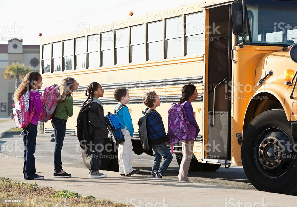 Children boarding school bus royalty-free stock photo