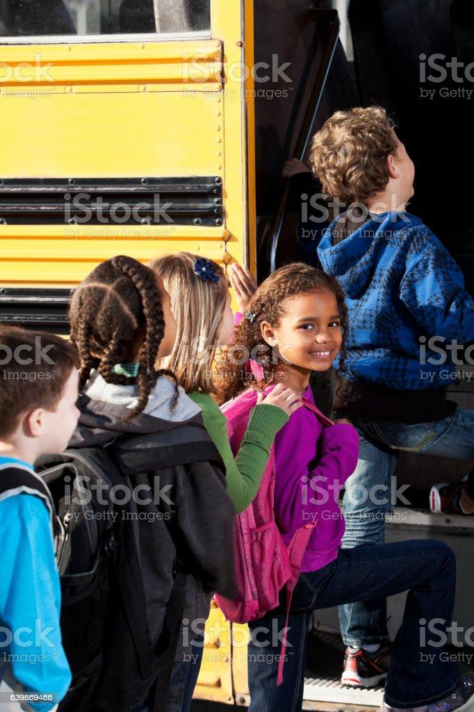 Children boarding school bus stock photo