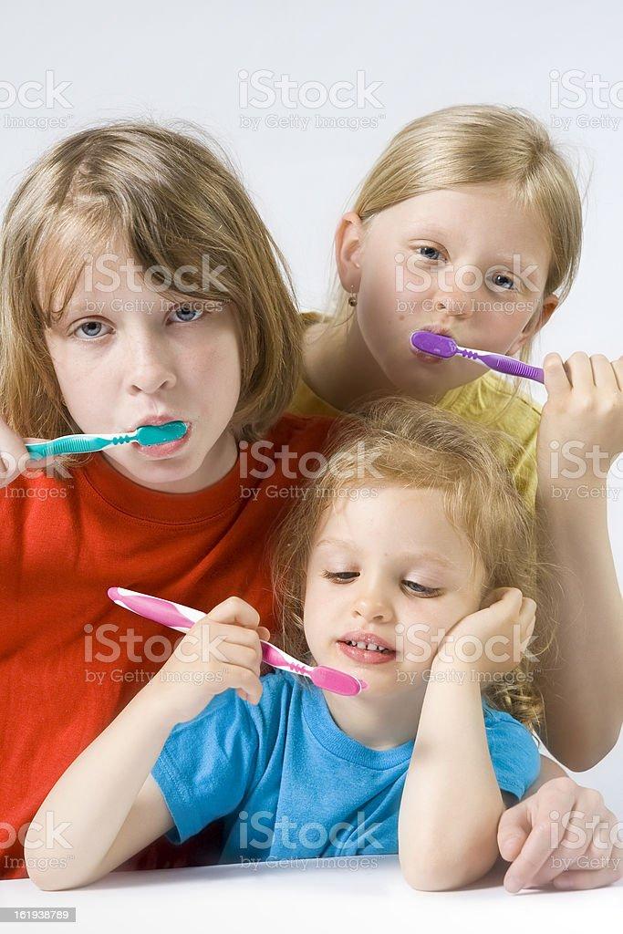 Children brushing teeth royalty-free stock photo