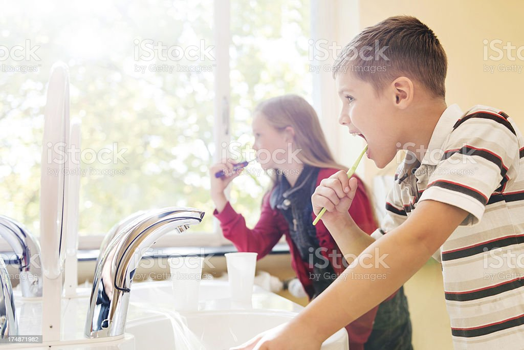 Children Brushing Teeth stock photo