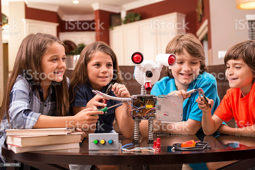 Children build robot together at home. stock photo