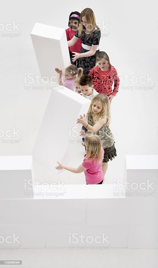 Children building a wall using blocks. royalty-free stock photo