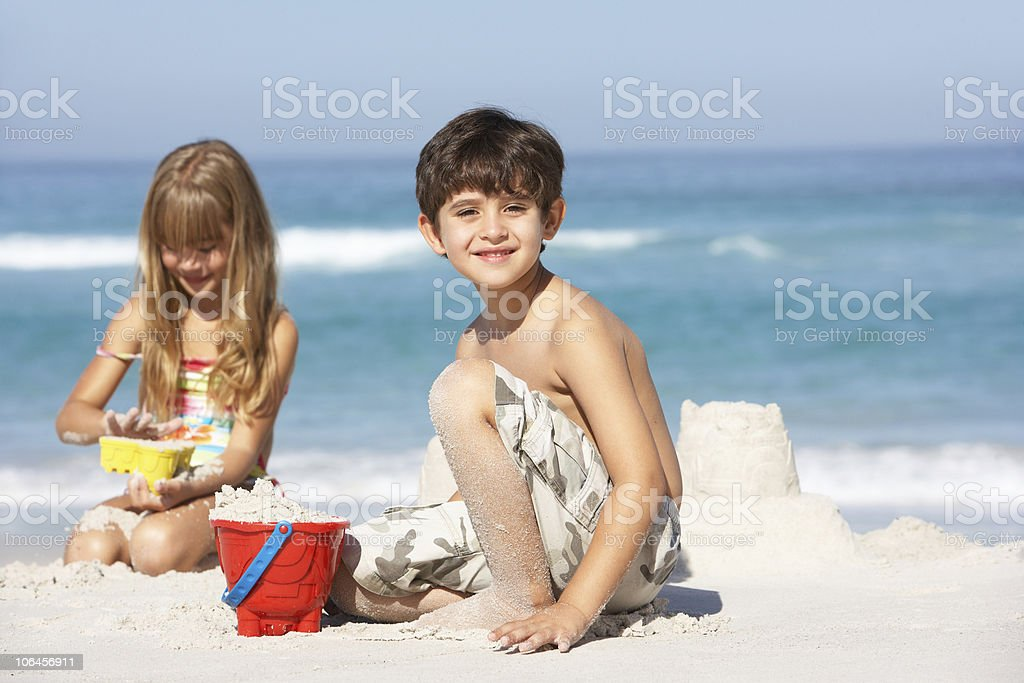 Children Building Sandcastles On Beach Holiday royalty-free stock photo