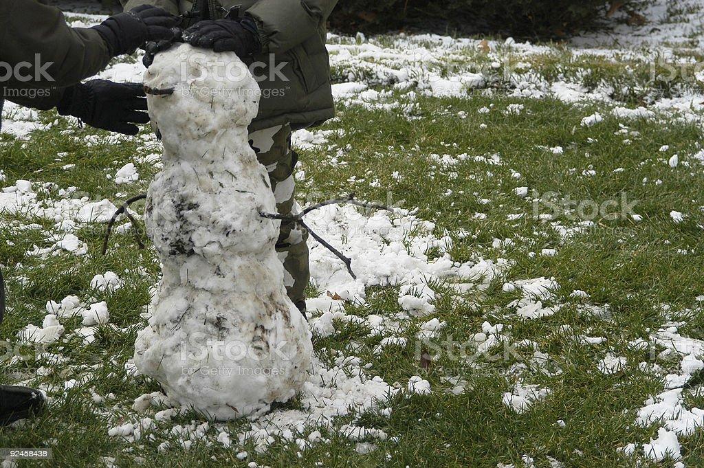 Children building snow man stock photo