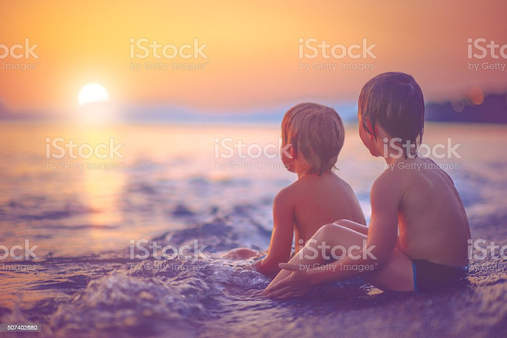 Children by the sea stock photo