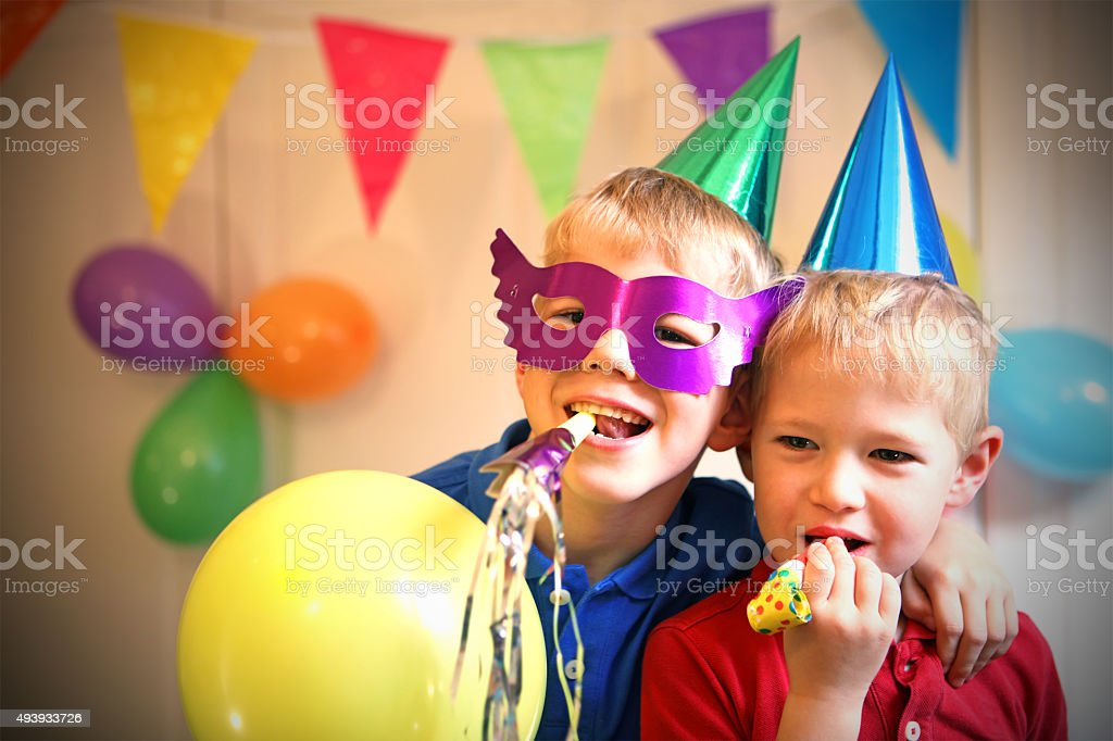 Children Celebrating a Birthday Party at Home stock photo