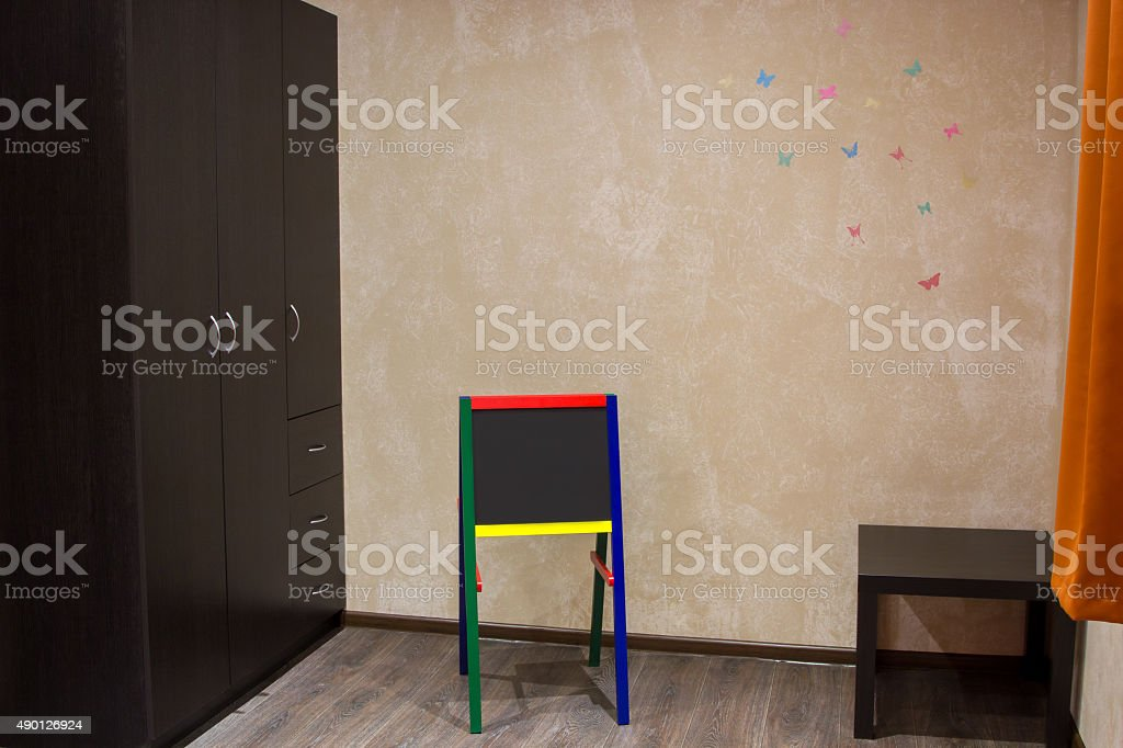 children chalkboard at a wall with painted butterflies stock photo