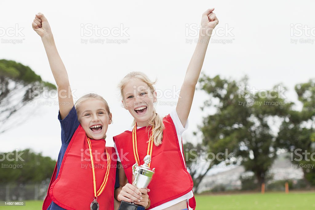 Children cheering with medal stock photo