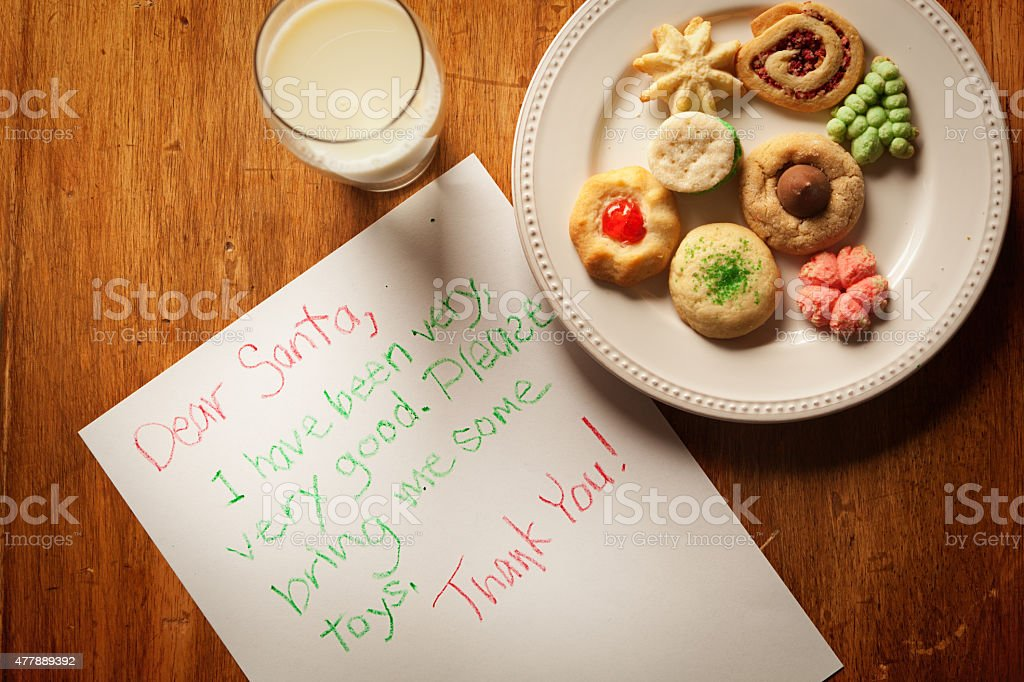 Children Christmas Letter Message to Santa Claus, Milk and Cookies stock photo