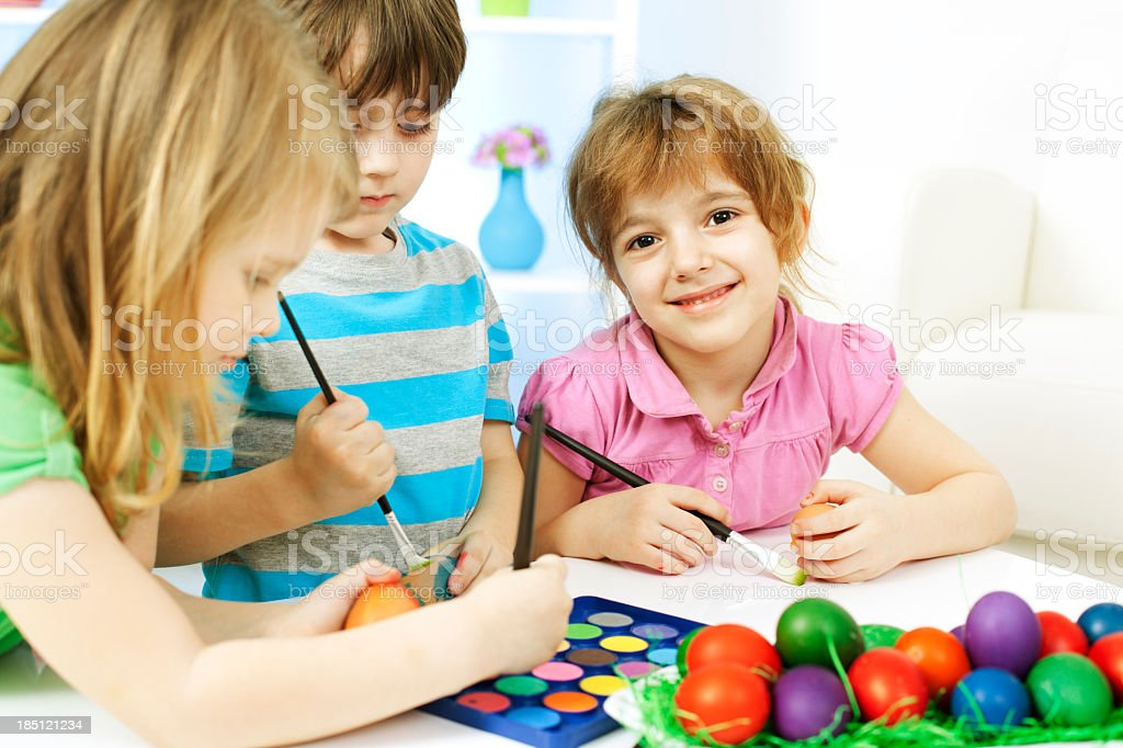 Children Coloring Easter Eggs royalty-free stock photo