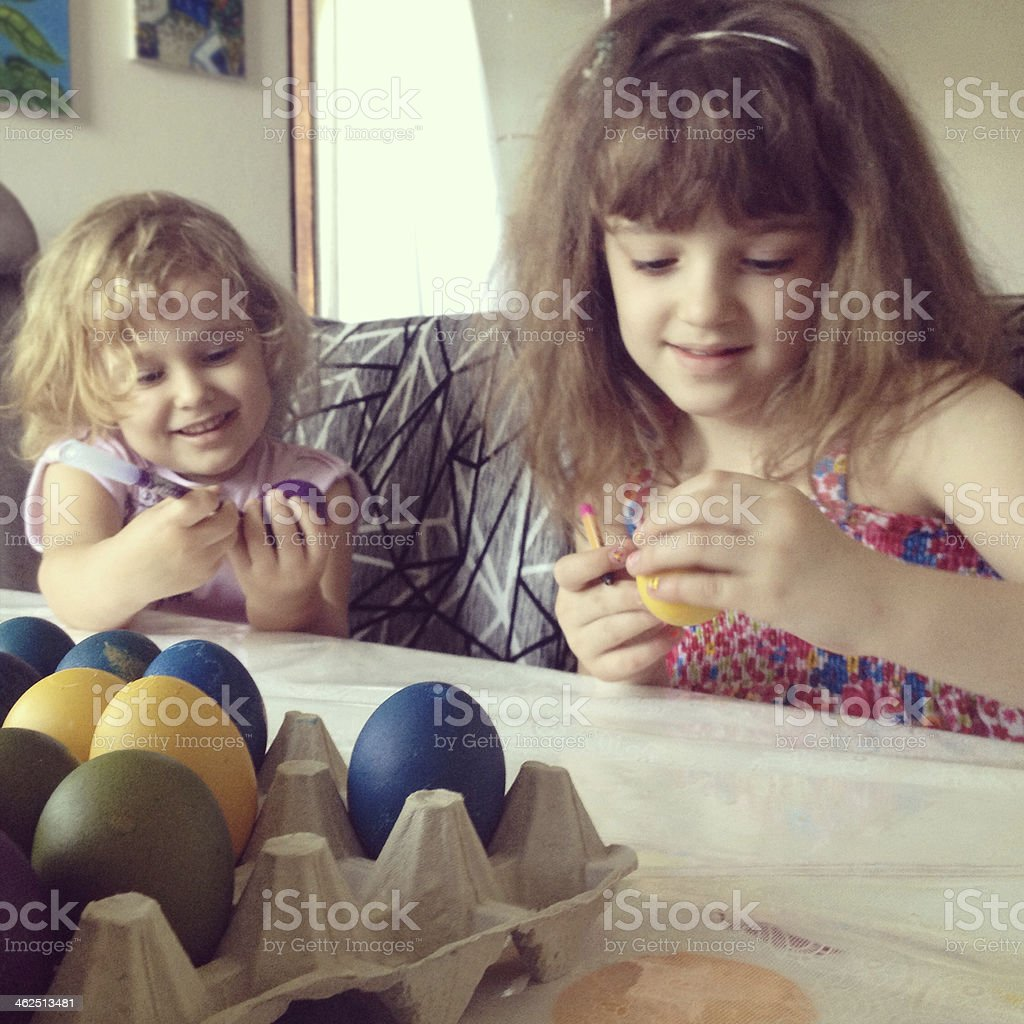 Children Coloring Easter Eggs. stock photo