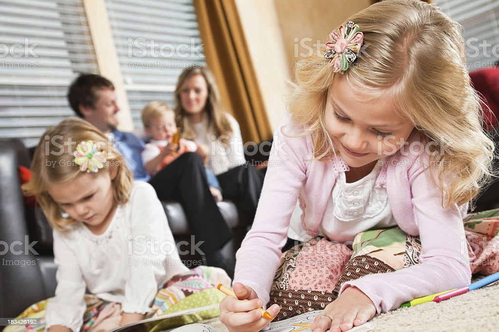 Children Coloring on floor in Living Room With Family royalty-free stock photo