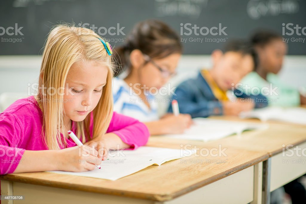 Children Coloring on Paper stock photo
