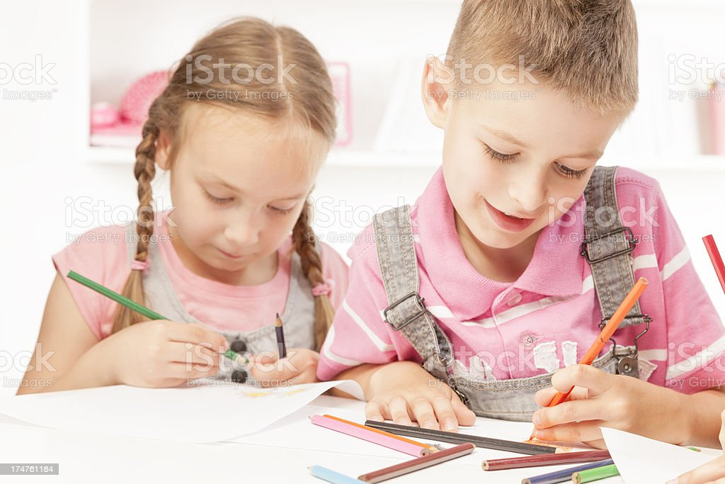 Children coloring with crayons royalty-free stock photo