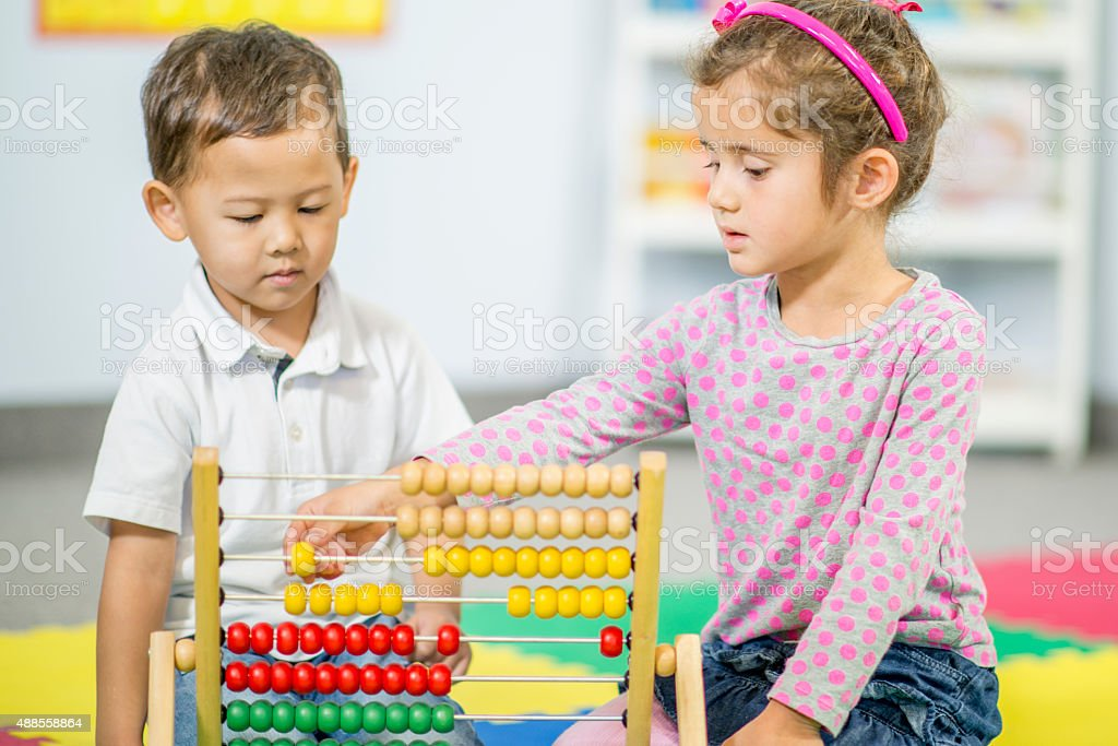 Children Counting on an Abacus stock photo