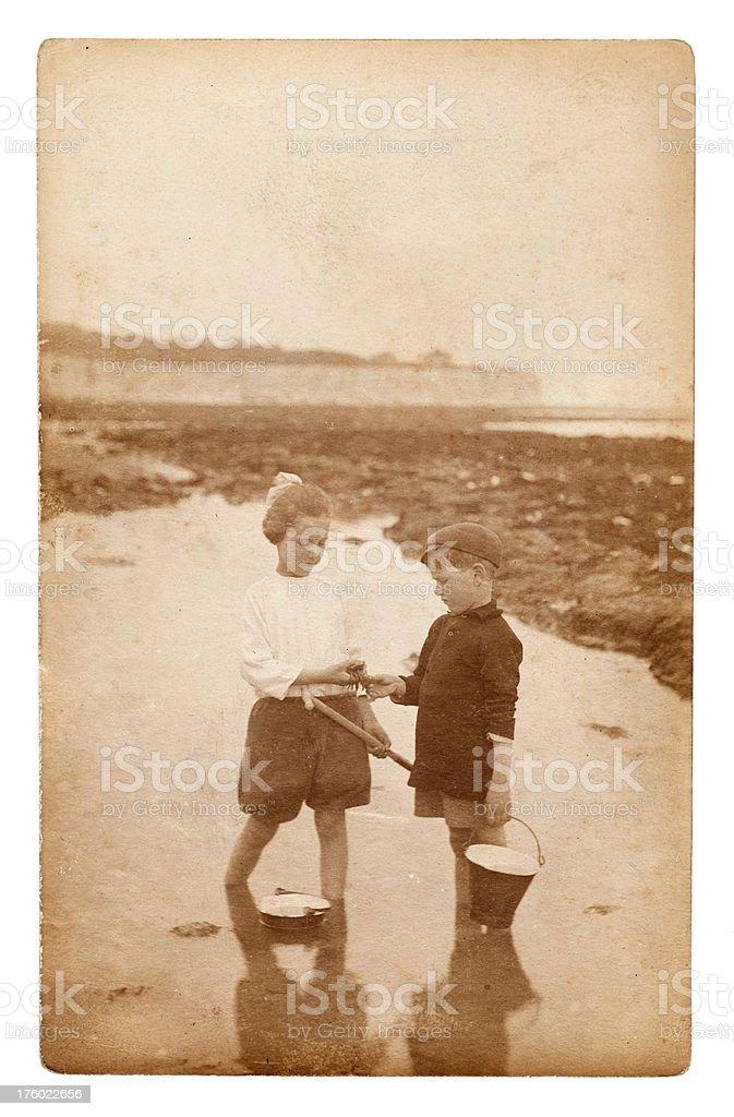 Children Crabbing at the Beach stock photo