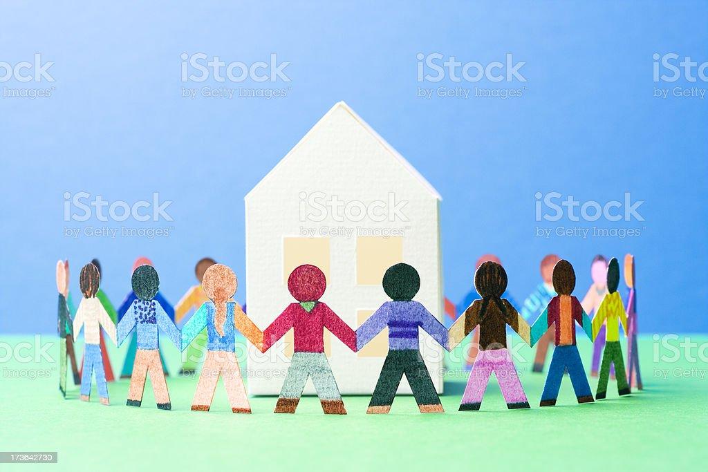 Children dancing around a house stock photo