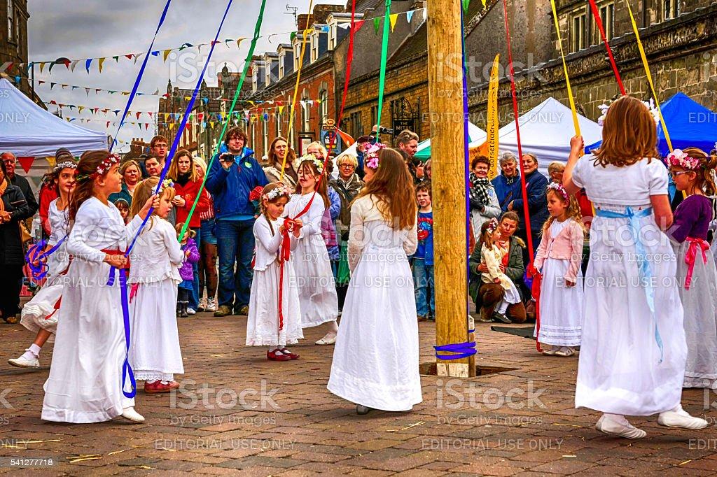 Children dancing around the Maypole at Shaftsbury, UK stock photo