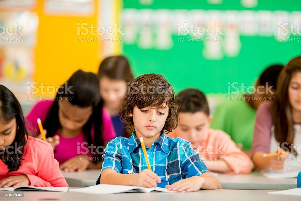 Children Doing a Homework Assignmnet stock photo