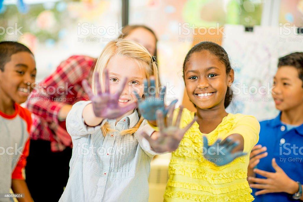 Children doing Hand Painting stock photo