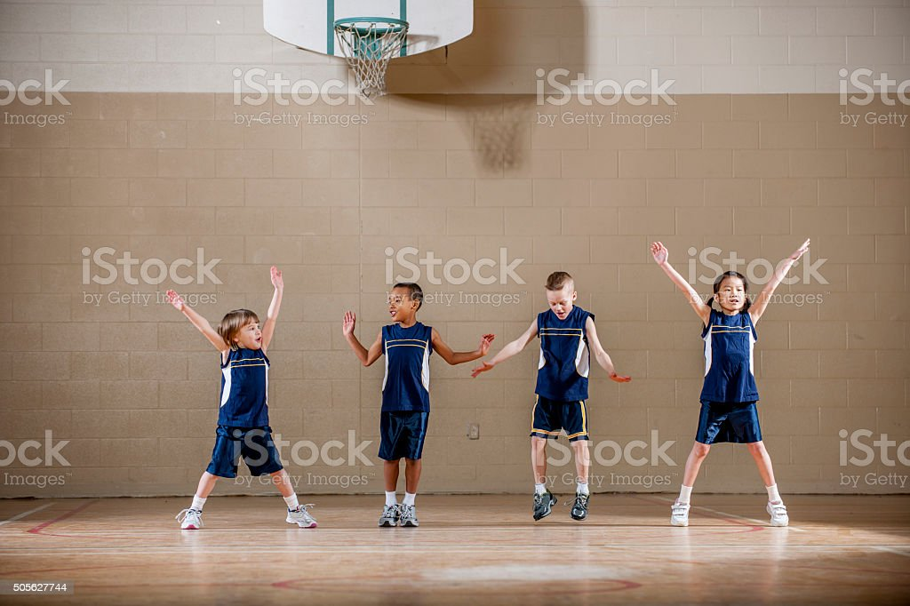 Children Doing Jumping Jacks stock photo