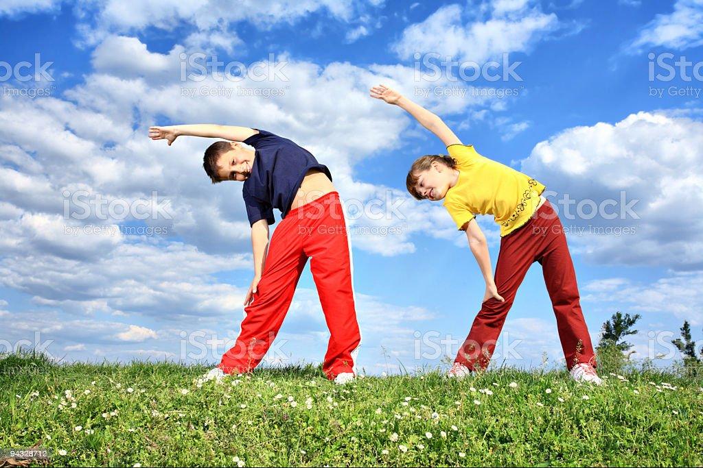 children doing sport outdoor. royalty-free stock photo