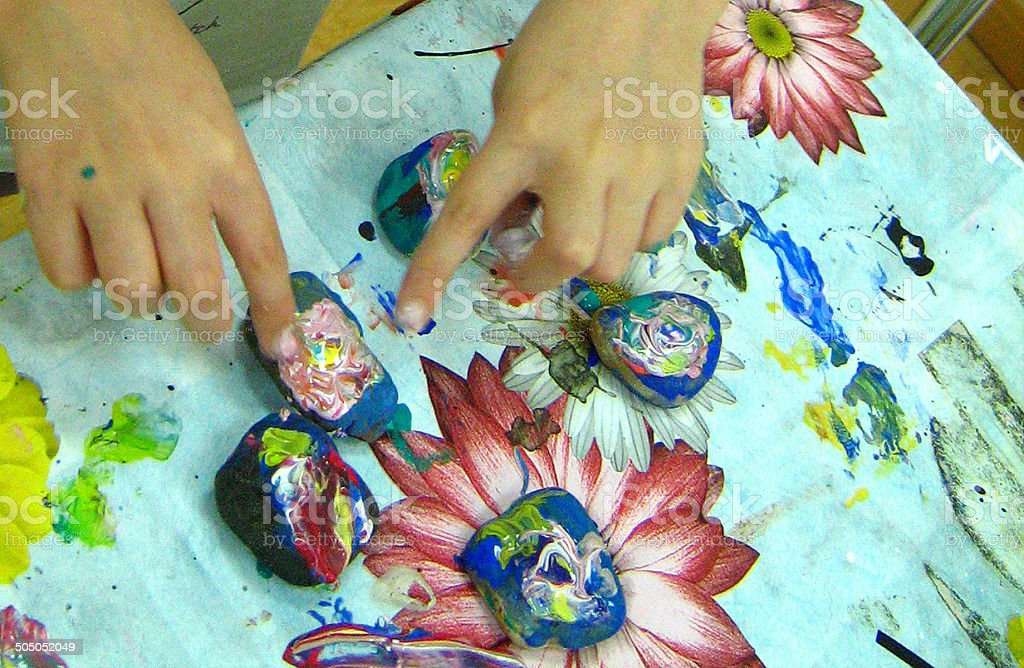 children draw on the stones stock photo