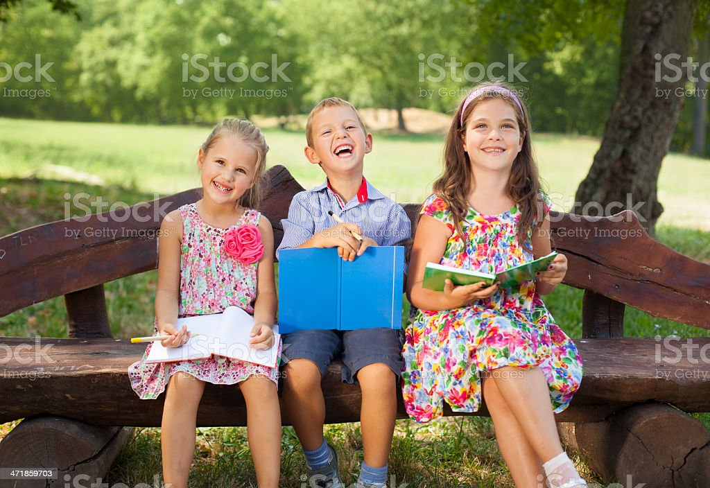 Children drawing on bench royalty-free stock photo
