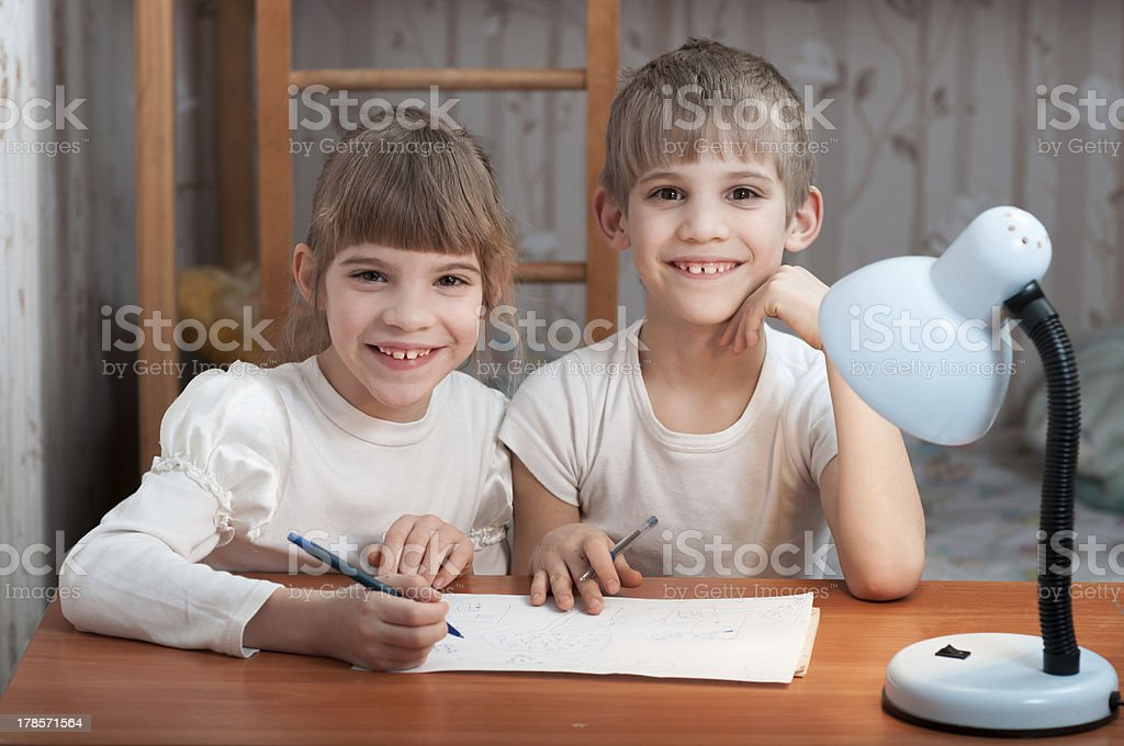 children drawing on paper royalty-free stock photo