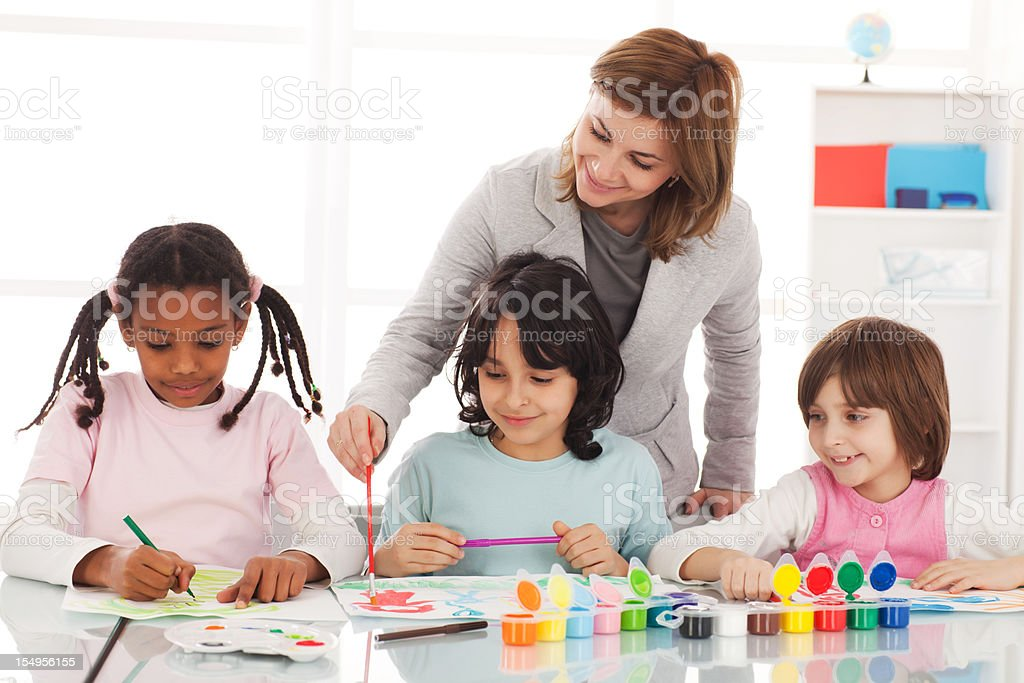 Children drawing with a watercolors on art class. royalty-free stock photo