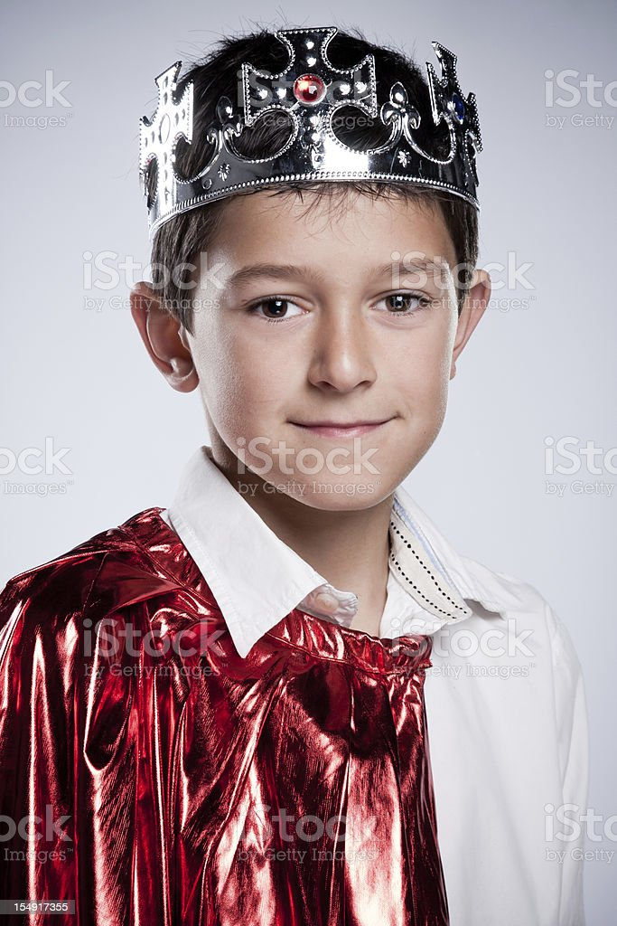 Children dressed as  a King. stock photo
