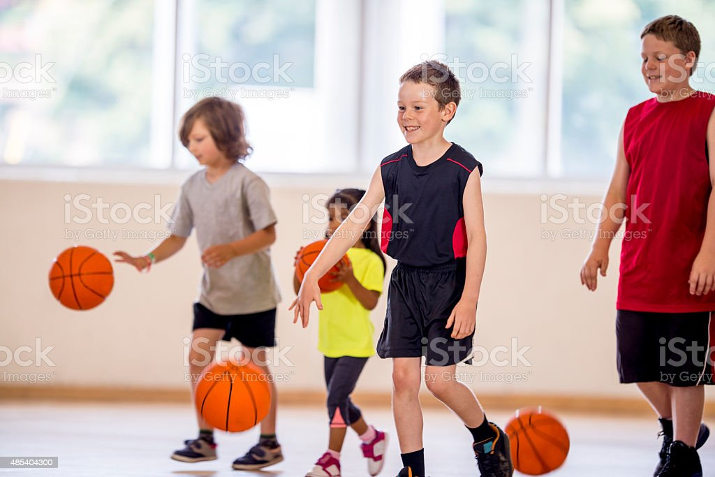 Children Dribbling a Basketball stock photo