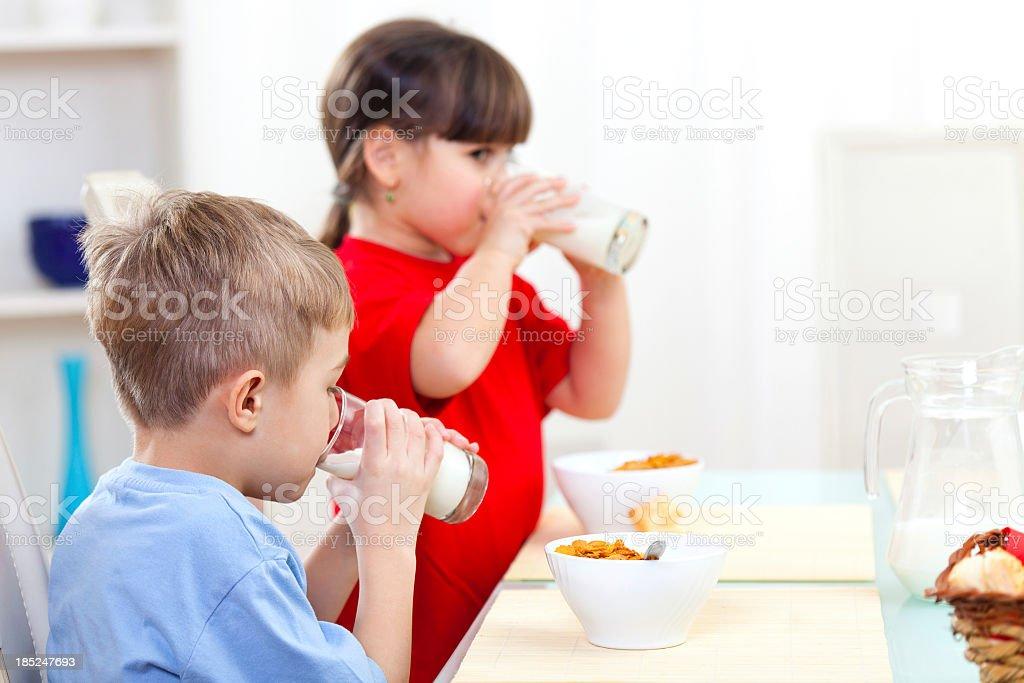 Children drinking milk royalty-free stock photo