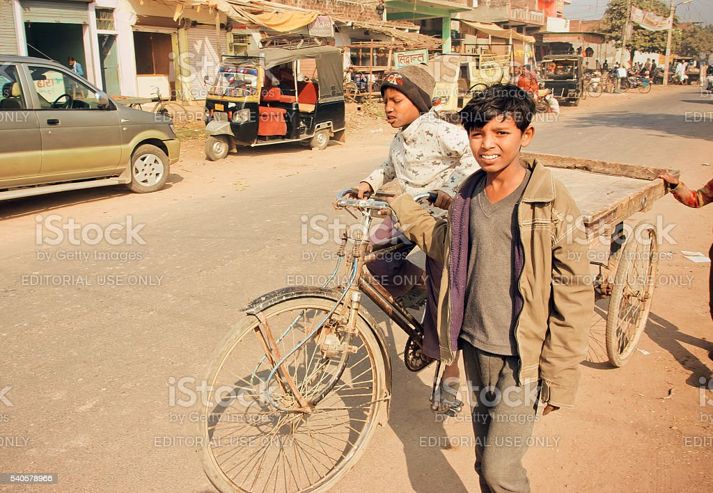 Children driving on bicycle in India stock photo