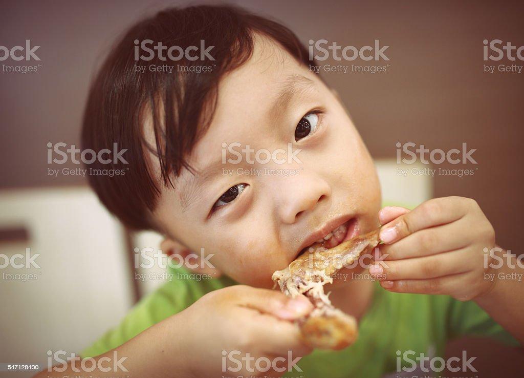 Children eat roast chicken wings stock photo