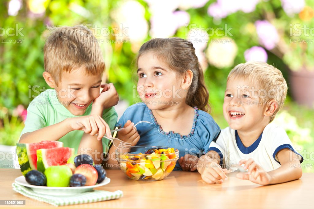 Children Eating Healthy Snack Outdoors royalty-free stock photo