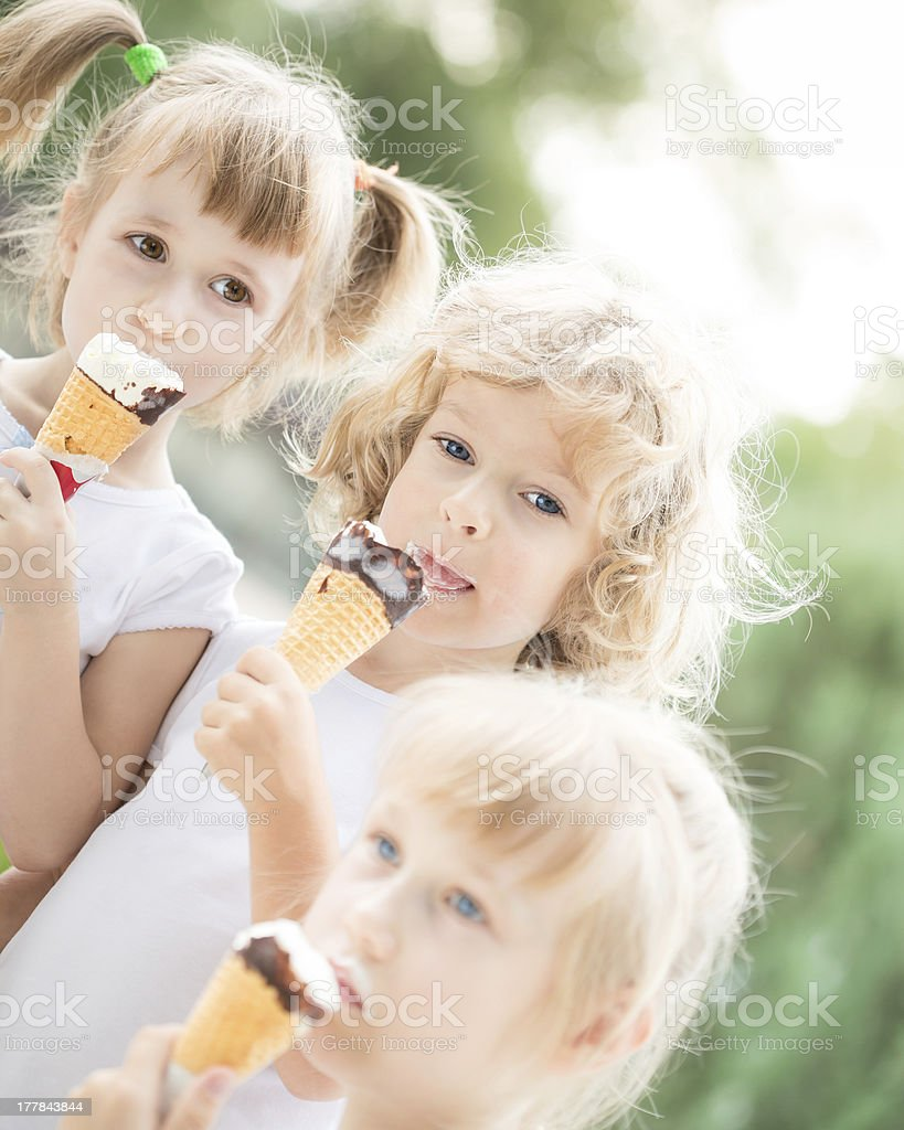 Children eating ice-cream royalty-free stock photo