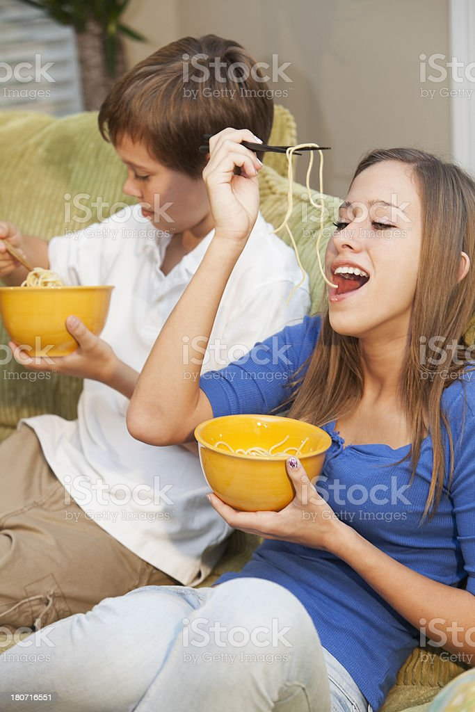 Children eating on couch stock photo