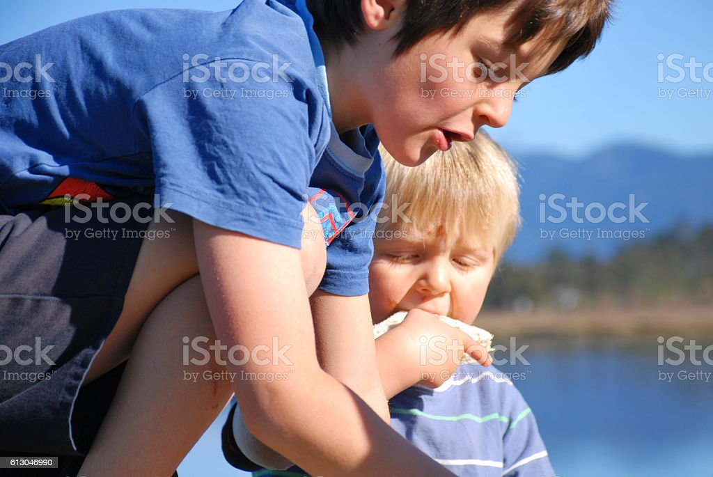 Children eating Picnic by the Sea stock photo