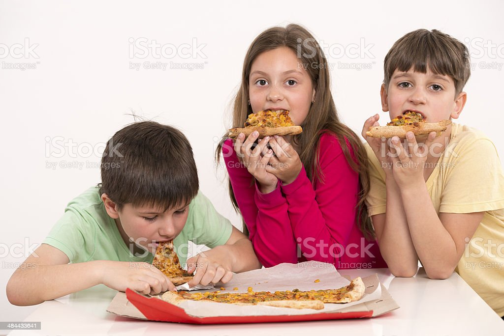 Children eating pizza. royalty-free stock photo