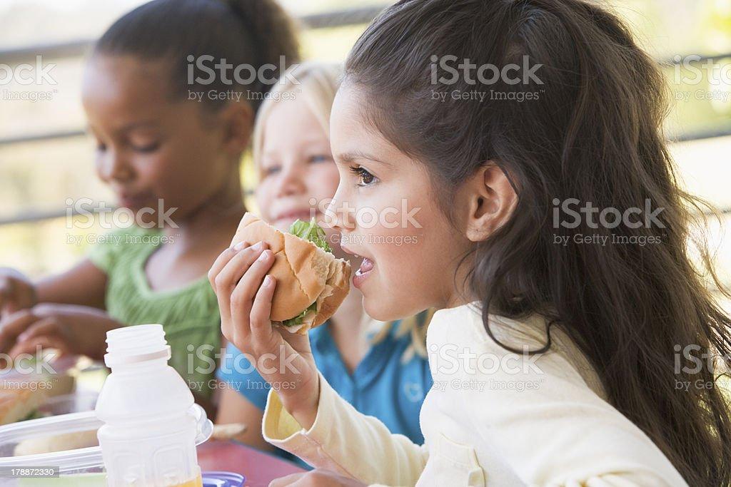 Children eating sandwiches in kindergarten stock photo