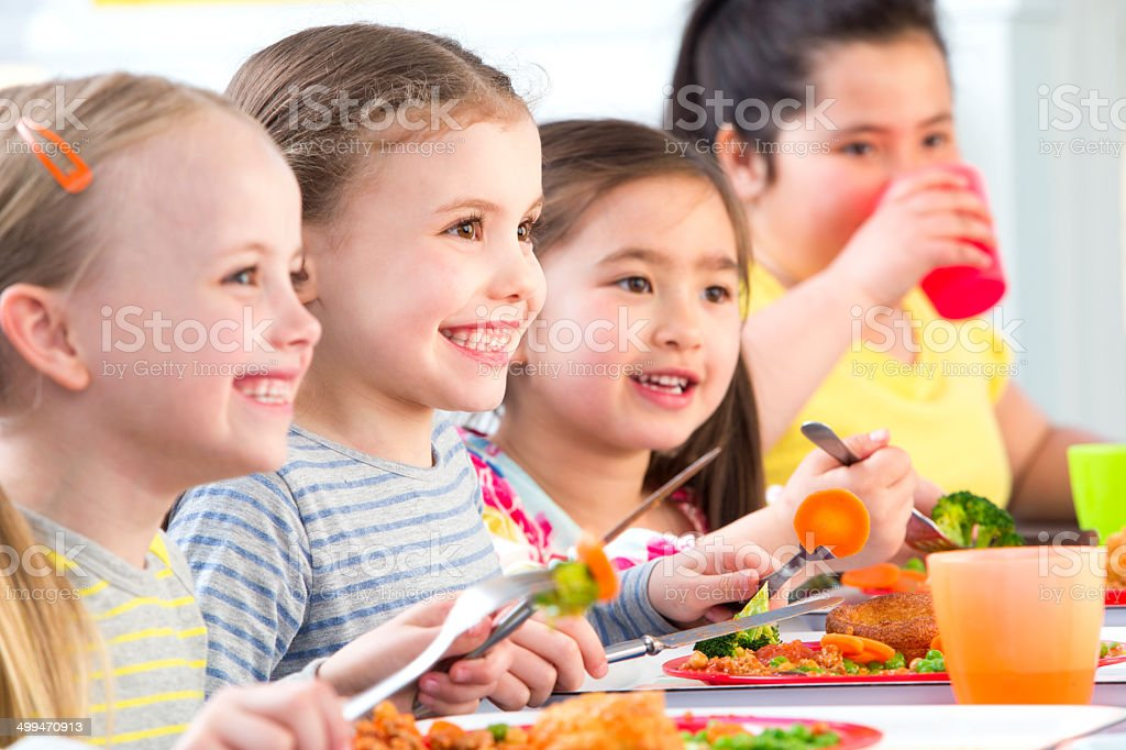 Children Eating School Dinners stock photo