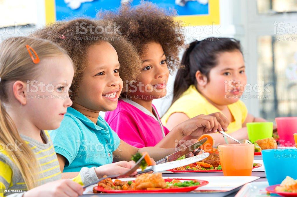 Children Eating School Dinners stock photo