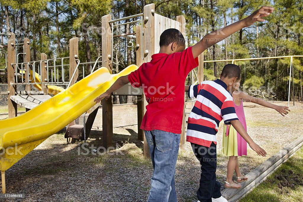 Children:  Elementary age students in a park, walking beams royalty-free stock photo