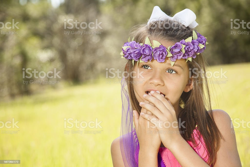 Children: Elementary child in tall grass admirng a butterfly royalty-free stock photo