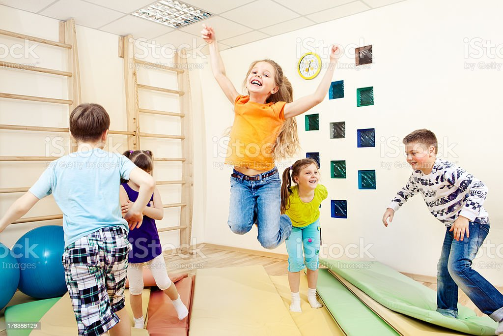 children enjoying gym class stock photo