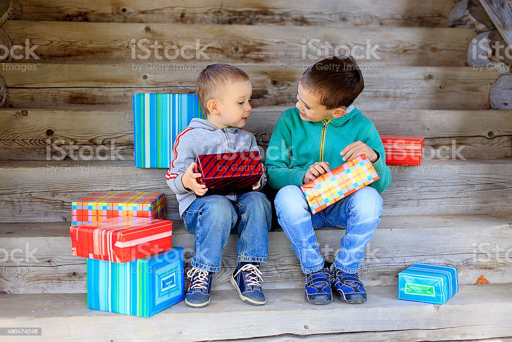 children exchanging gifts stock photo