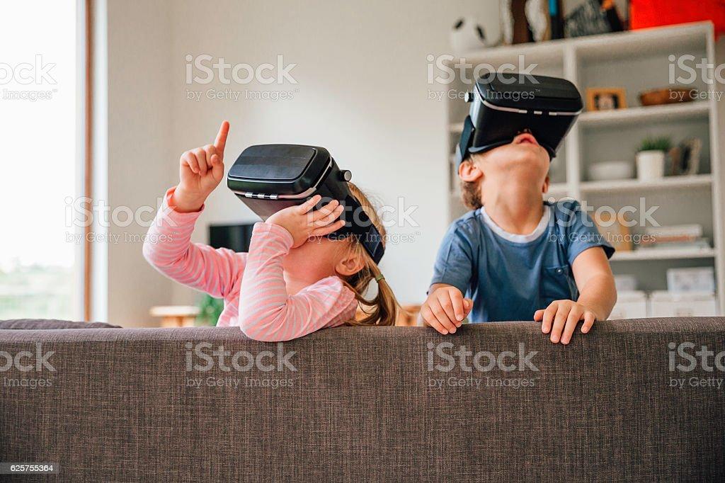 Children Exploring Virtual Reality Technology stock photo