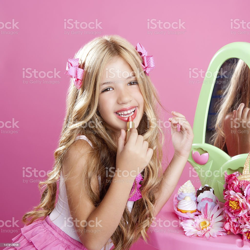 children fashion doll little girl lipstick makeup pink vanity stock photo