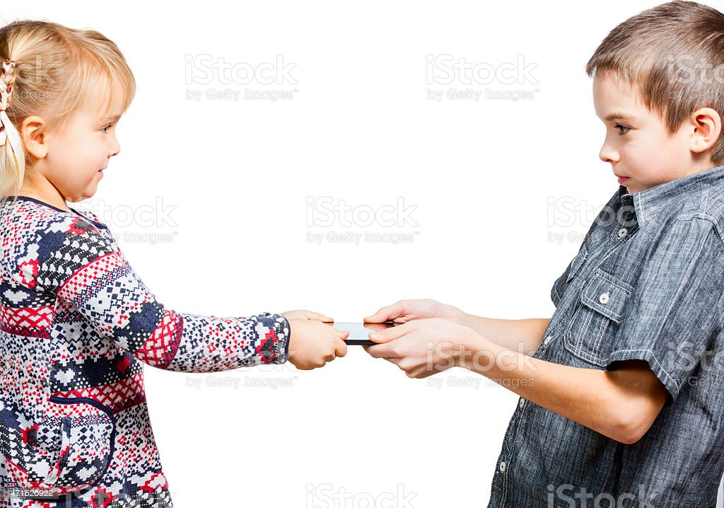 Children fight for tablet computer stock photo